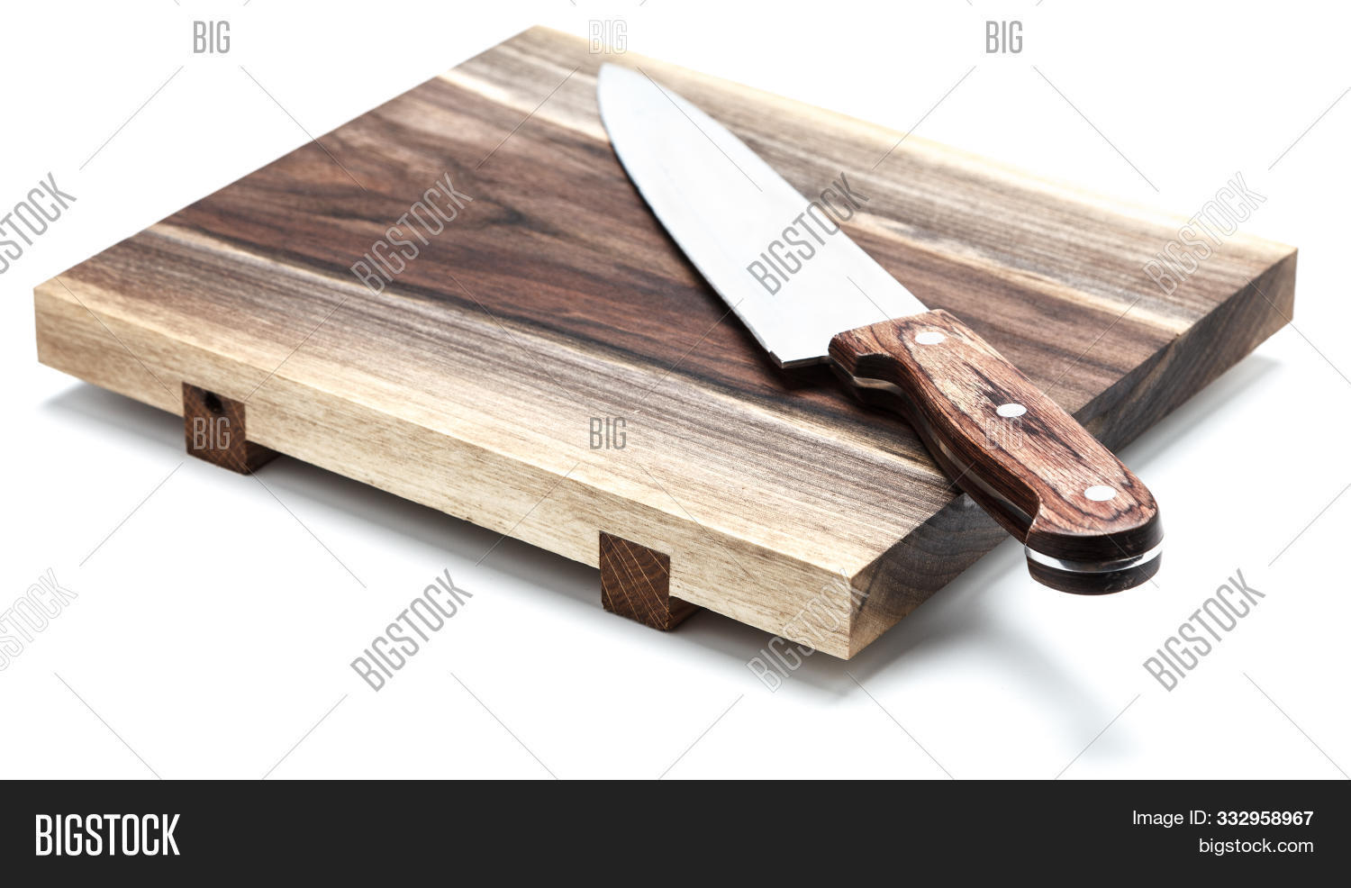 Kitchen Knife Lying On A Cutting Board, White Background