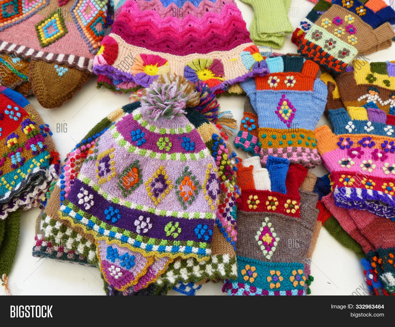Handcraft Souvenirs From Peru: Colorful Woolen Knitted Hats And Gloves With Tradition Design At The