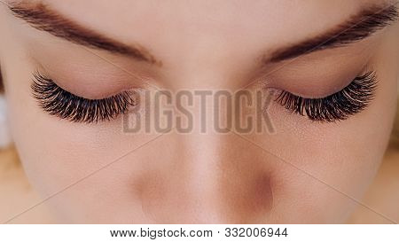 Eyelash Extension Procedure. Woman Eye With Long Blue Eyelashes. Ombre Effect. Close Up, Selective F