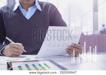 Businessman Or Accountant Working In The Office Reviewing Financial Statements For Business Performa