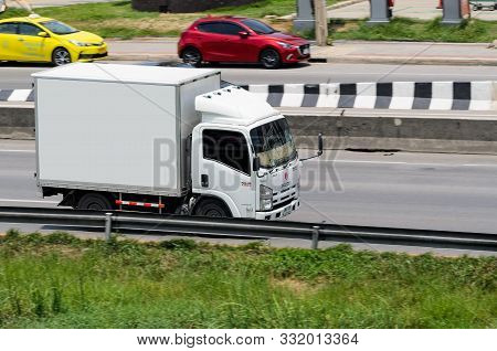 Samut Sakhon, Thailand - May 2019: A Small White Truck Running On Rama 2 Road On May 26, 2019 At Sam