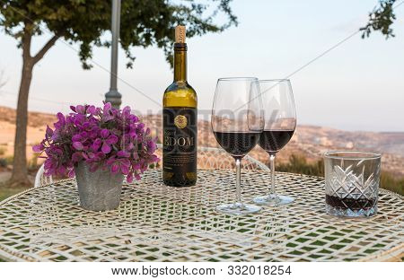 Rosh Haayin, Israel, October 31, 2019 : View At Sunset On A Bottle Of Wine Psagot, Glasses Of Wine A