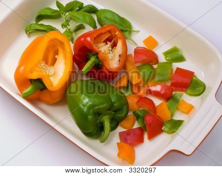 Three Peppers Cut In Preparation.
