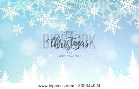 Merry Christmas Hand Lettering On Blur Background With Snowflakes. Typography For Christmas And Wint
