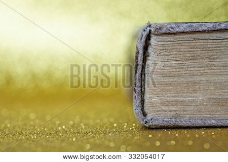 The Spine Of An Old Thick Book Lies On A Yellow Background. Library Archive. History And Memoirs. Ed