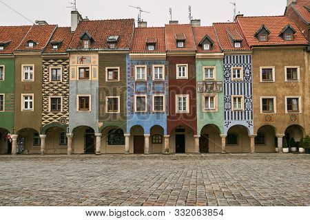 cobbled market and facades of historic tenement houses in Poznan poster