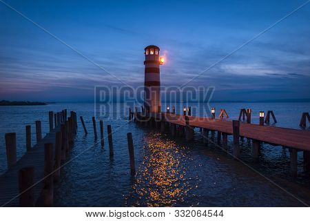 Lighthouse At Lake Neusiedl, Podersdorf Am See, Burgenland, Austria. Lighthouse At Sunset In Austria