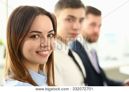 Portrait Of Beautiful Business Woman Looking At Camera With Great Joy And Calmness. Pretty Lady Sitt