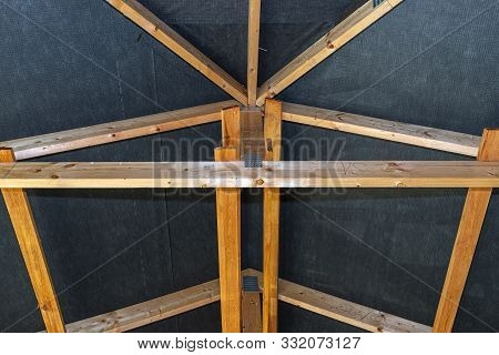 Roof Trusses Covered With A Membrane On A Detached House Under Construction, View From The Inside, V