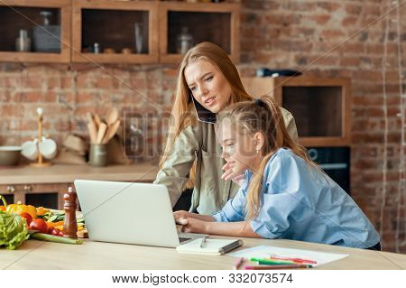 Kids Need Attention. Blondy Daughter Interrupting Her Busy Mom While Woman Talking By Phone, Using L
