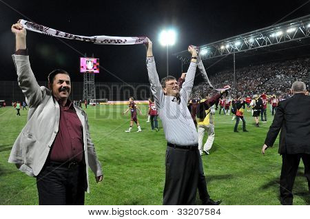 Soccer managers celebrating the league title
