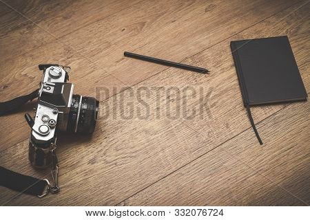Retro Style Objects For Blogging Photography And Writing On Vintage Wooden Background