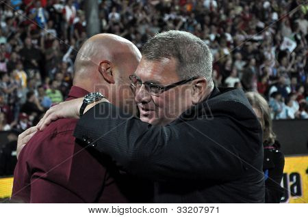 FC CFR soccer club owner and manager celebrating a victory