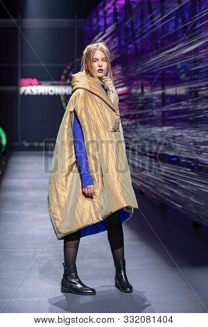 ZAGREB, CROATIA - OCTOBER 26, 2019: Fashion model wears clothes designed by famous Croatian designer Branka Donassy at the 'Fashion.hr' fashion show