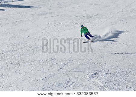 Pyrenees, Andorra - February 16, 2019: A Skier Descends From The Mountain At High Speed At A Ski Res