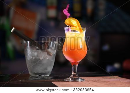 Alcoholic Cocktail Tequila Sunrise. Shot Tequila Sunrise At The Bar.