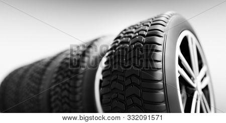 Wheels with modern alu rims on white background - banner. 3D illustration