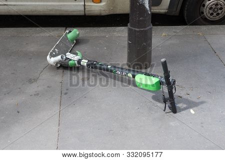 Broken Electric Scooter On The Road In Paris, France 10-9-19. This Depict 2 Major Ecological Problem