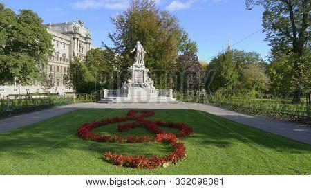 Vienna, Austria-october, 9, 2017: Wide Shot Of A Mozart Statue And Gardens In Vienna, Austria