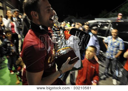 Football player with the golden ball trophy