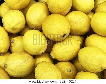 Yellow Lemon Fruit, Citrus Limon (l.) Consist Of Citric Acid Compound, Yellow Texture Or Background,
