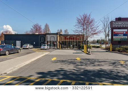 Coquitlam, Canada - March 31, 2019: Shopping Mall In City Center With Tim Hortons And Parking Lots.