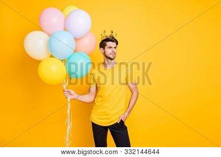 Photo Of Handsome Boast Guy Holding Air Balloons Golden Crown On Head Shows High Social Status Wear