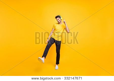Full Length Photo Of Handsome Guy At Students Party Listening Youth Music Earflaps Dancing Youngster