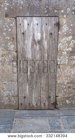 Old Wooden Uncoated Door In Pornic, Granite Stone Wall France 17-9-19