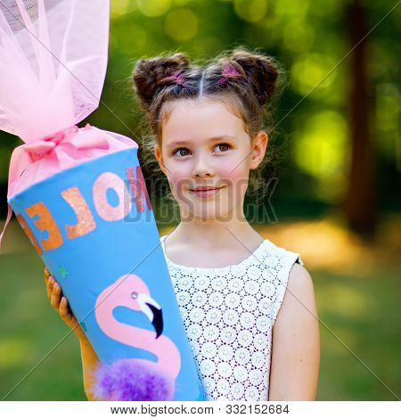 Happy Little Kid Girl With Backpack Or Satchel And Big School Bag Or Cone Traditional In Germany For