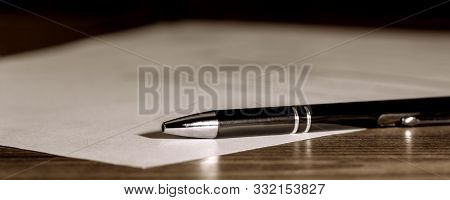 Banner, Pen And Paper On Wooden Table, Concept Contract, Submission Or Last Will, Copyspace