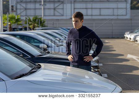 Car Dealership Customer Chooses The Car. A Row Of New Cars Parked At A Car Dealership Stock