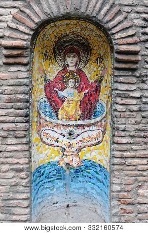 Icon Of The Mother Of God Undeclared Bowl On A Brick Wall. Icon Of The Mother Of God Undeclared Bowl