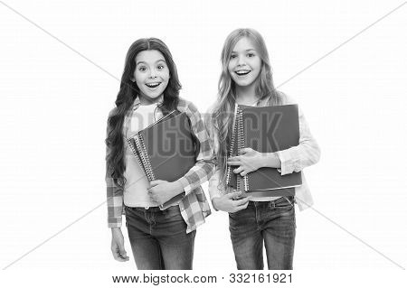 Pads Perfect For The Academic Use. Cute Small School Children Holding Note Pads. Adorable Little Gir