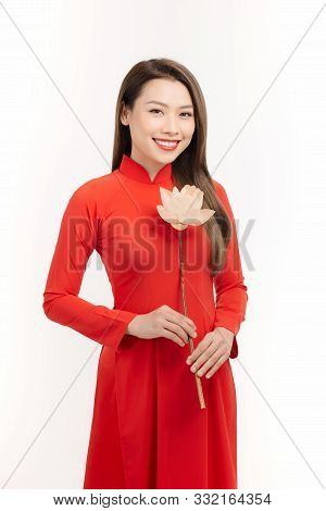 Vietnamese girl holding a lotus flower, The Ao dai ( long-dress Vietnamese) is traditional costume of Vietnamese woman poster