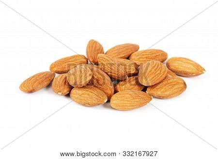 Pile Of Fresh Raw Almonds Isolated On White Background.
