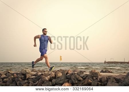 Pain Is Nothing Compared To What It Feels Like To Quit. Running Man On Beach. Runner Training Outdoo