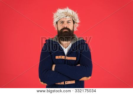 Clothes Design. Man Bearded Stand Warm Jumper And Hat On Red Background. Winter Season Menswear. Hip