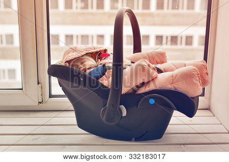 Childhood And Safety Concept - Infant Baby Girl Sleeping In Child Car Seat