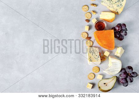 Cheese Assortment On Light Background. Top View