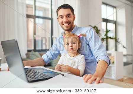 multi-tasking, freelance and fatherhood concept - working father with baby daughter and laptop computer at home office