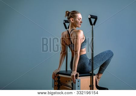 Palates Trainer Girl Posing For A Reformer In The Gym. Fitness Concept, Special Fitness Equipment, H
