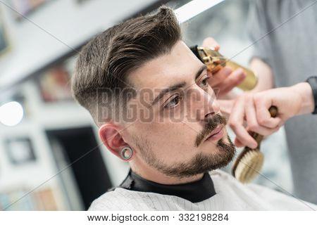 Haircut And Beard Haircut In Barbershop. Man Haircut