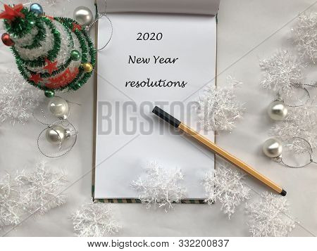 New Year Resolutions. 2020 New Year. New Year Concept. White Notebook Sheet With Pen On White Backgr