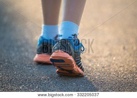 Kid Walking, Exercising On A Rural Road, Close Up On Kids Feet Wearing Gym Shoes