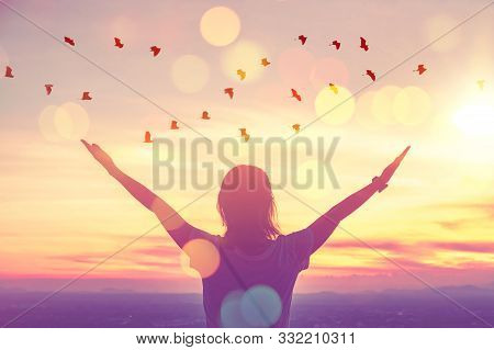 Freedom Feel Good And Travel Adventure Concept. Copy Space Of Silhouette Woman Rising Hands On Sunse