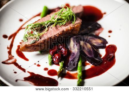 Duck Breast Served On A Plate In Restaurant