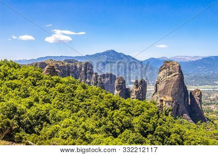 Scenic Meteora Valley View With The Holy Monastery Of Rousanou, Part Of The Eastern Orthodox Monaste