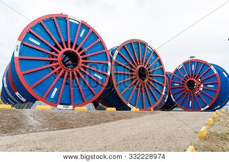 Le Trait, Seine-maritime / France - 13 August 2019: Empty Subsea Umbilical Cable Reels Ready For Rel