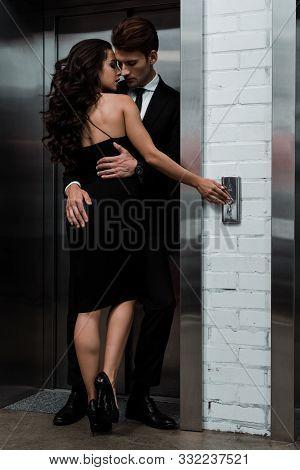 Beautiful Sensual Couple Hugging And Flirting Near Lift
